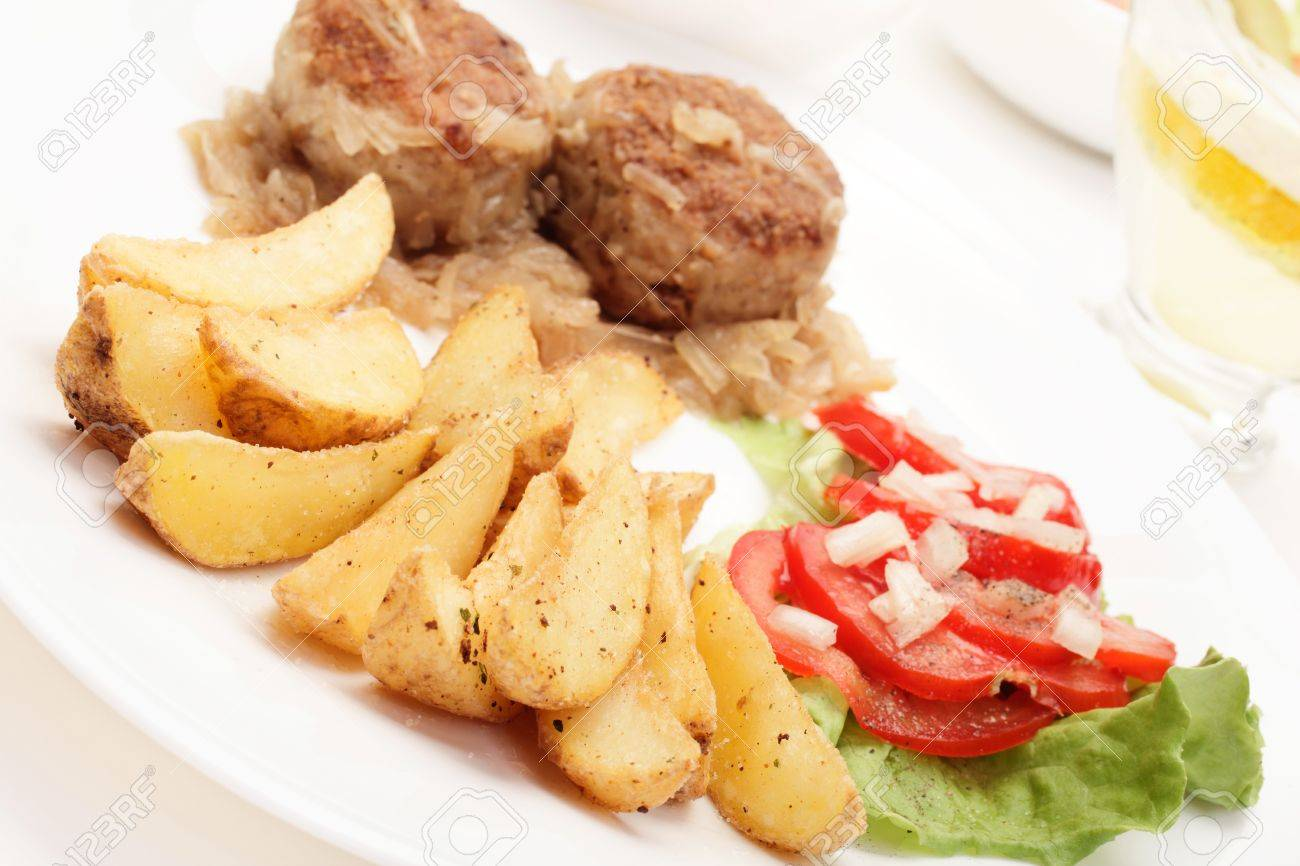 Meat With Stewed Onion And Fried Potato Wedges Stock Photo 19209068