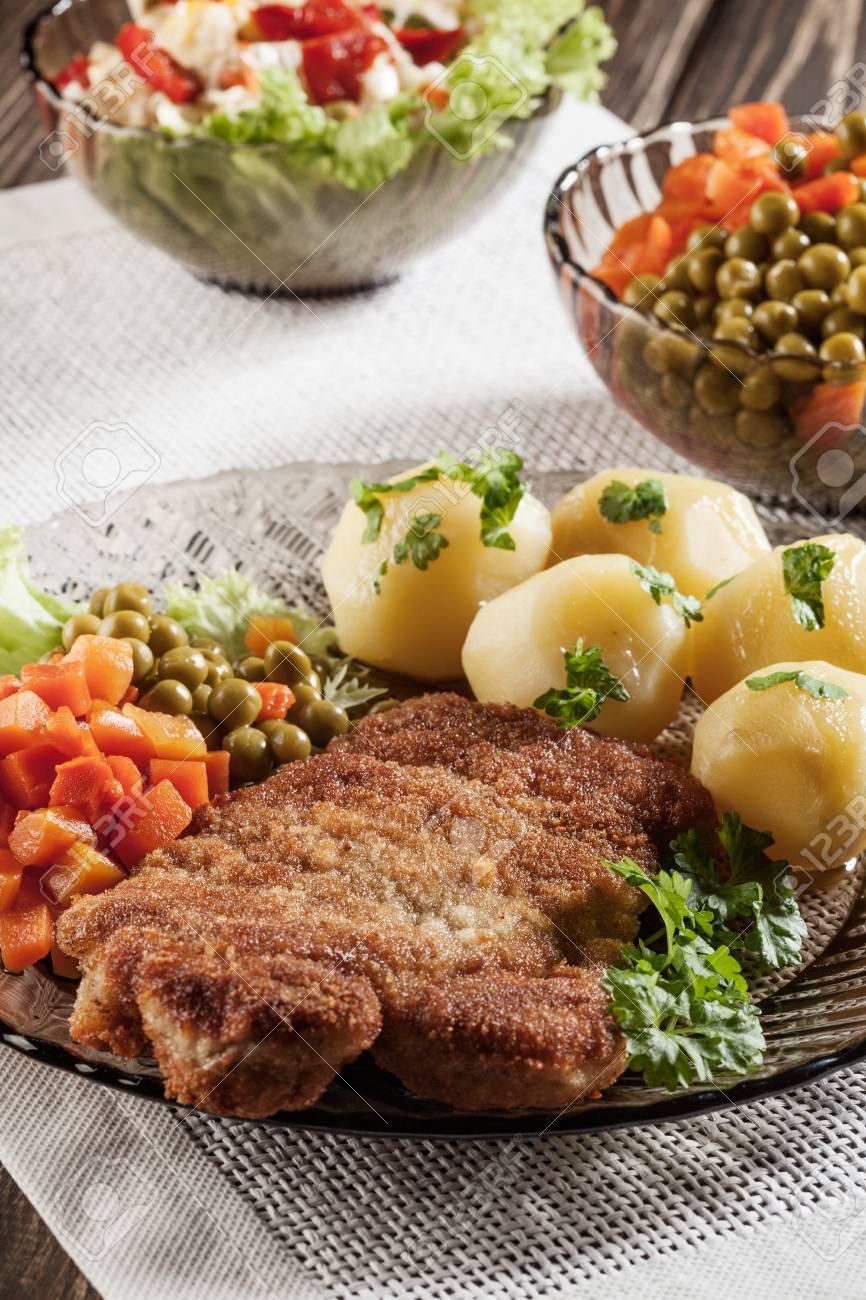 Breaded chop and potatoes  Dark light Stock Photo - 19398903