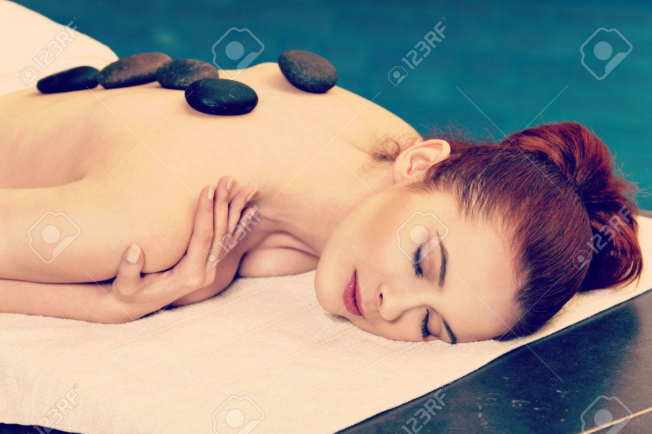 Stock Photo Stone Massage Sensual Woman Getting A Hot Stone Massage At Spa Salon Instagram Style