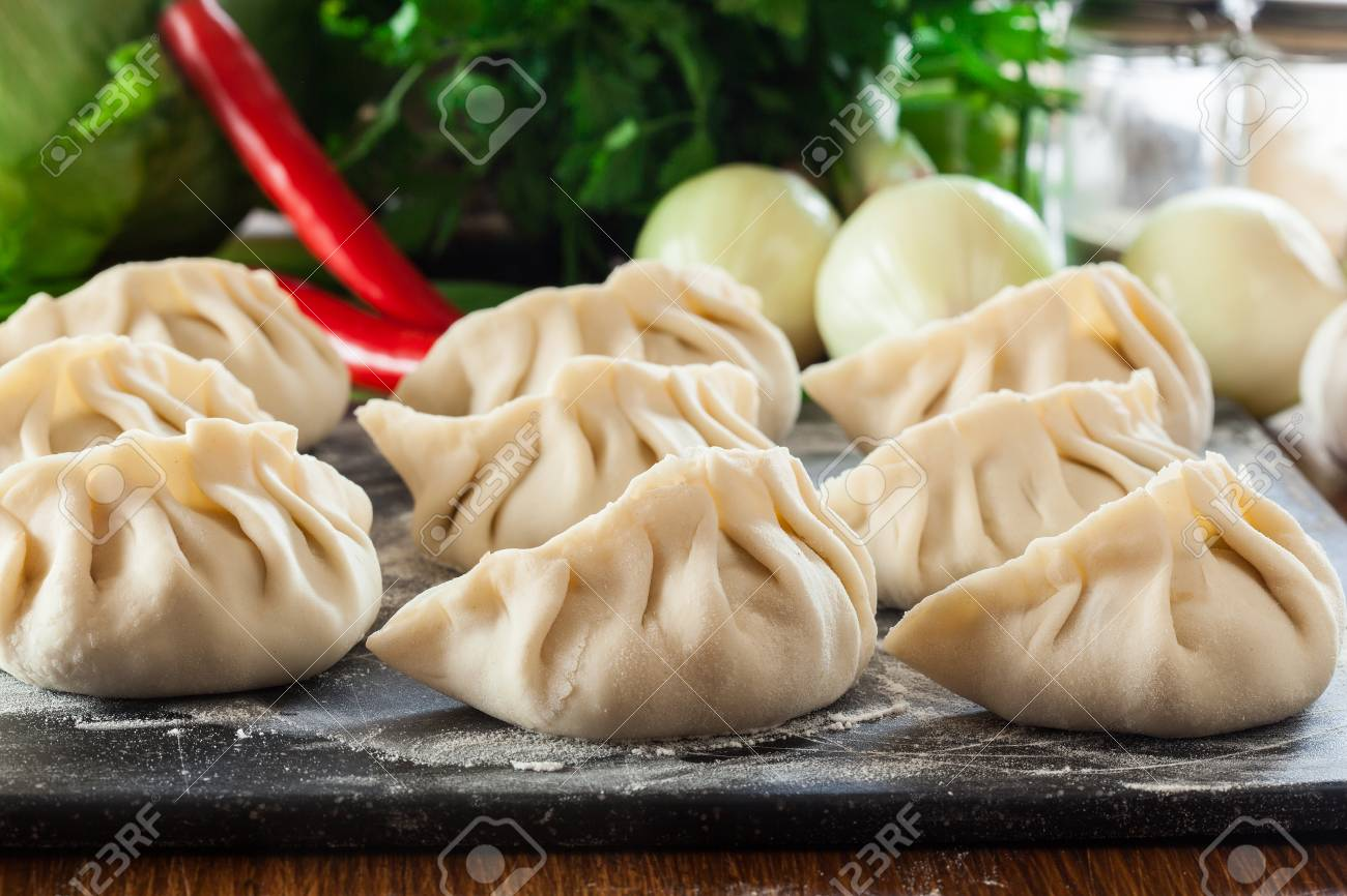Raw Gyoza Or Jiaozi Dumplings Ready For Cooking Chinese And Stock Photo Picture And Royalty Free Image Image 94822375