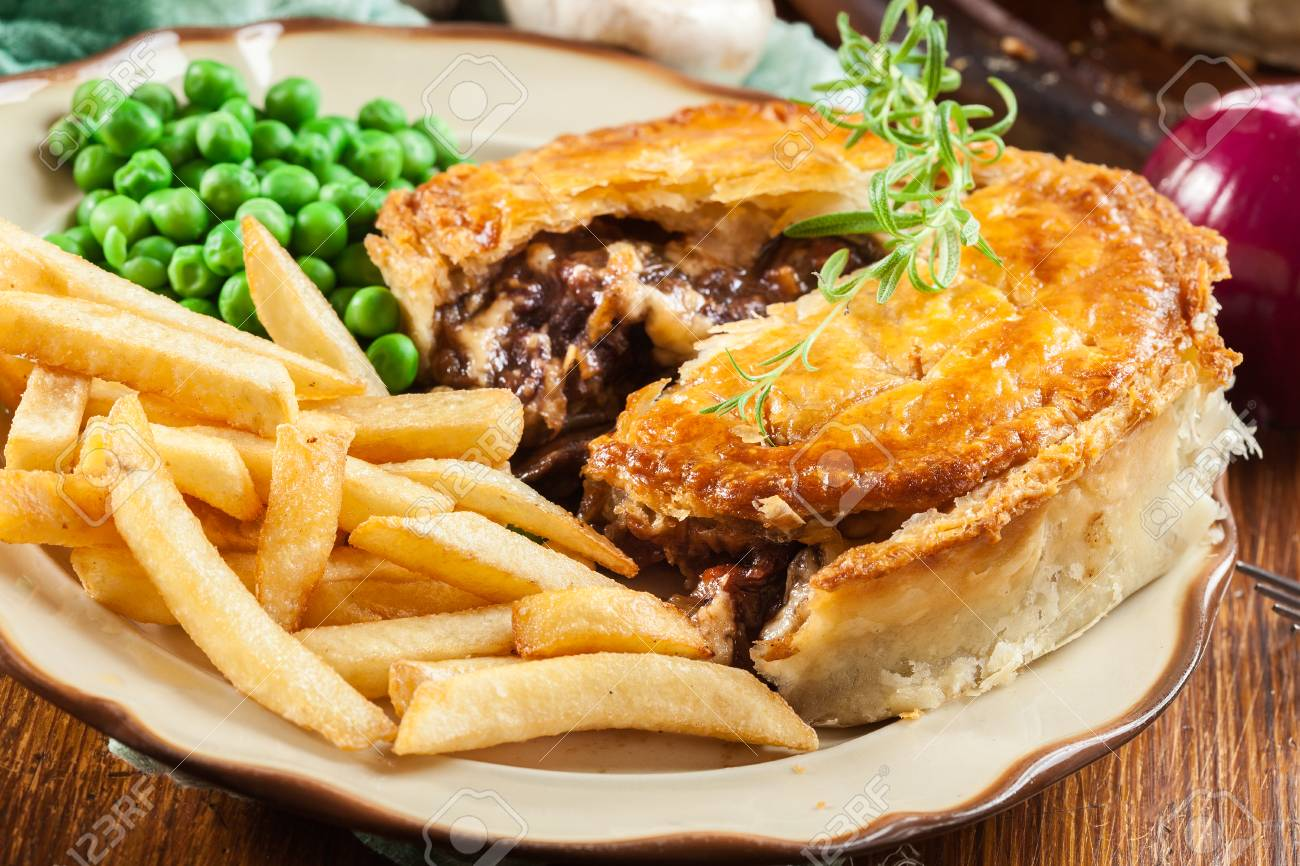 Homemade Beef Stew Pie With French Fries Meat In Puff Pastry Stock Photo Picture And Royalty Free Image Image 105072287