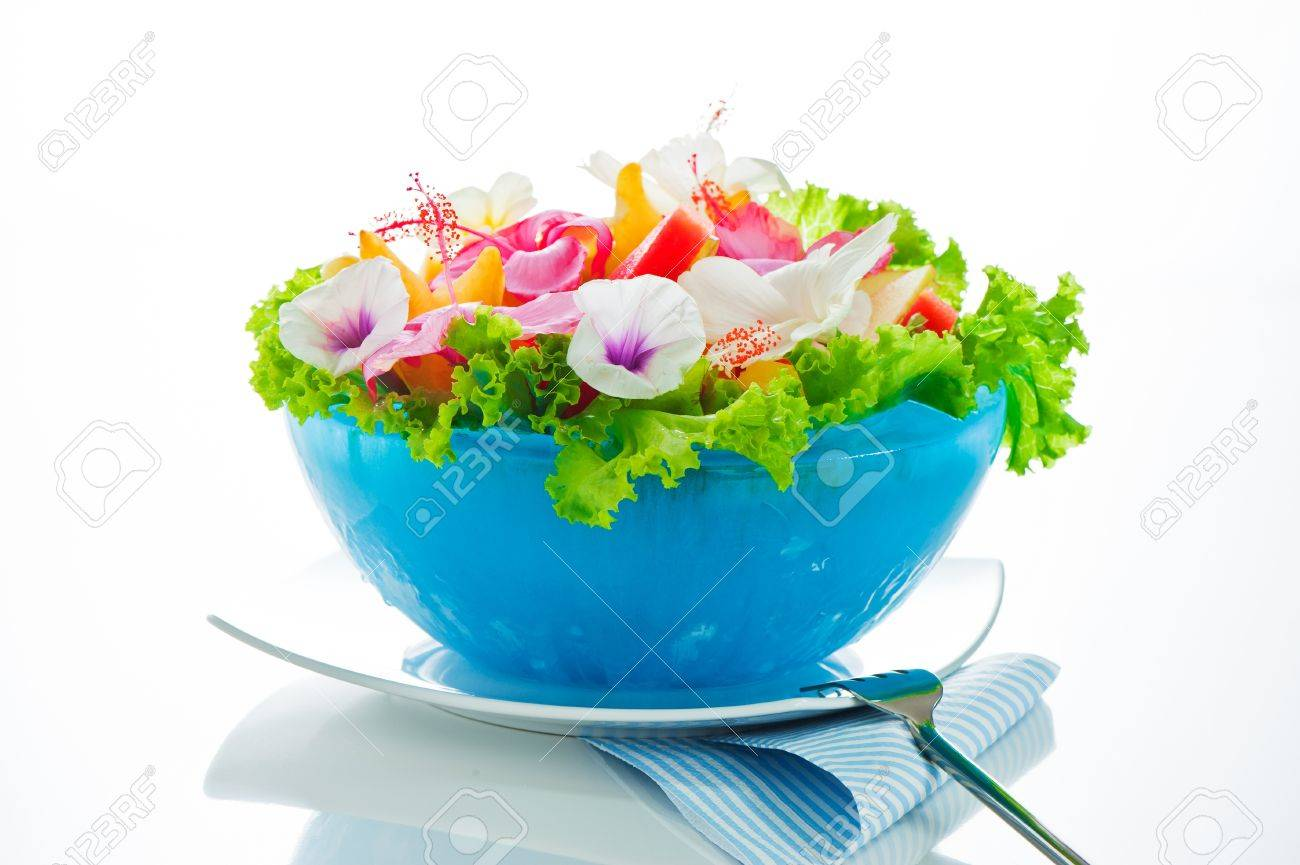 Fruit salad with edible flowers in a blue bowl from ice on white background Stock Photo - 11765881