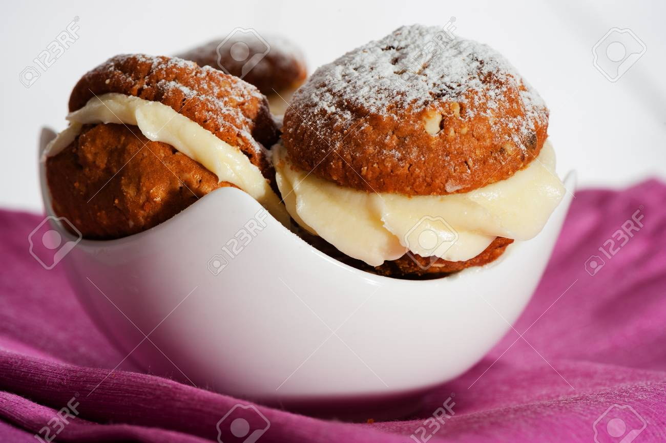 Nuts chocolate cookies with vanilla cream in a white bowl as a studio shot Stock Photo - 15053016