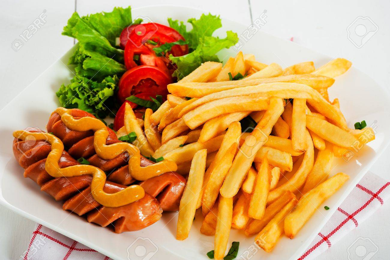 Potatoes fries with sausage mustard and tomato salad - 15096400