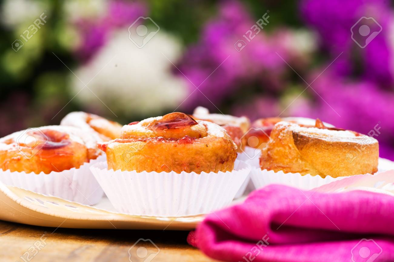 small cake with strawberry jam on white plate Stock Photo - 24512670