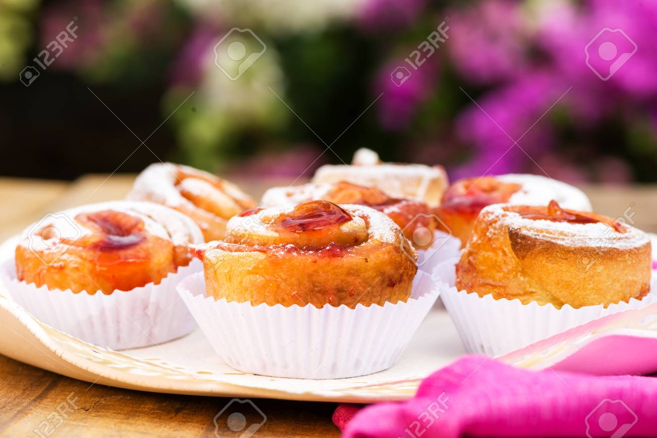 small cake with strawberry jam on white plate Stock Photo - 24512671