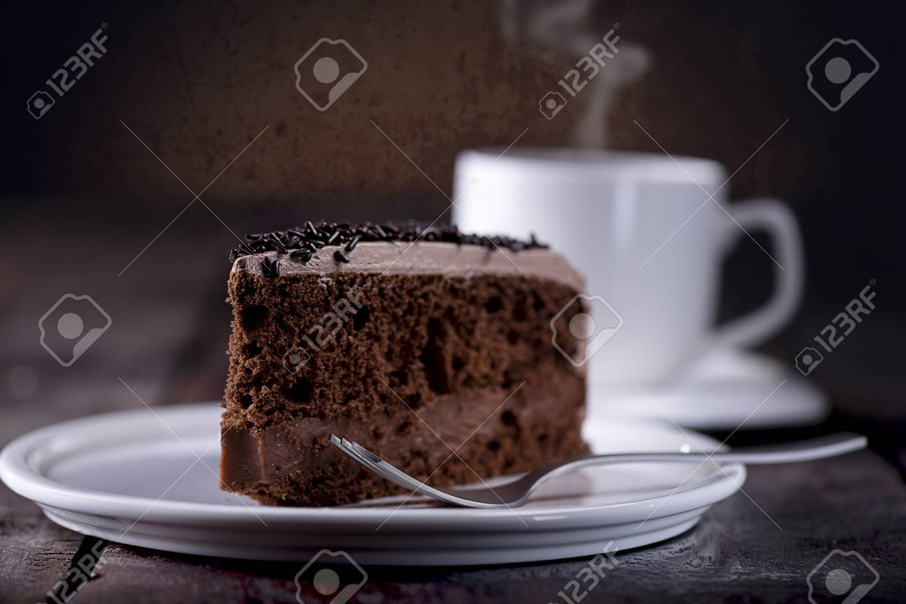 Piece Of Chocolate Cake And A Fork On The Right Side A Cup Of Stock Photo Picture And Royalty Free Image Image 56685813