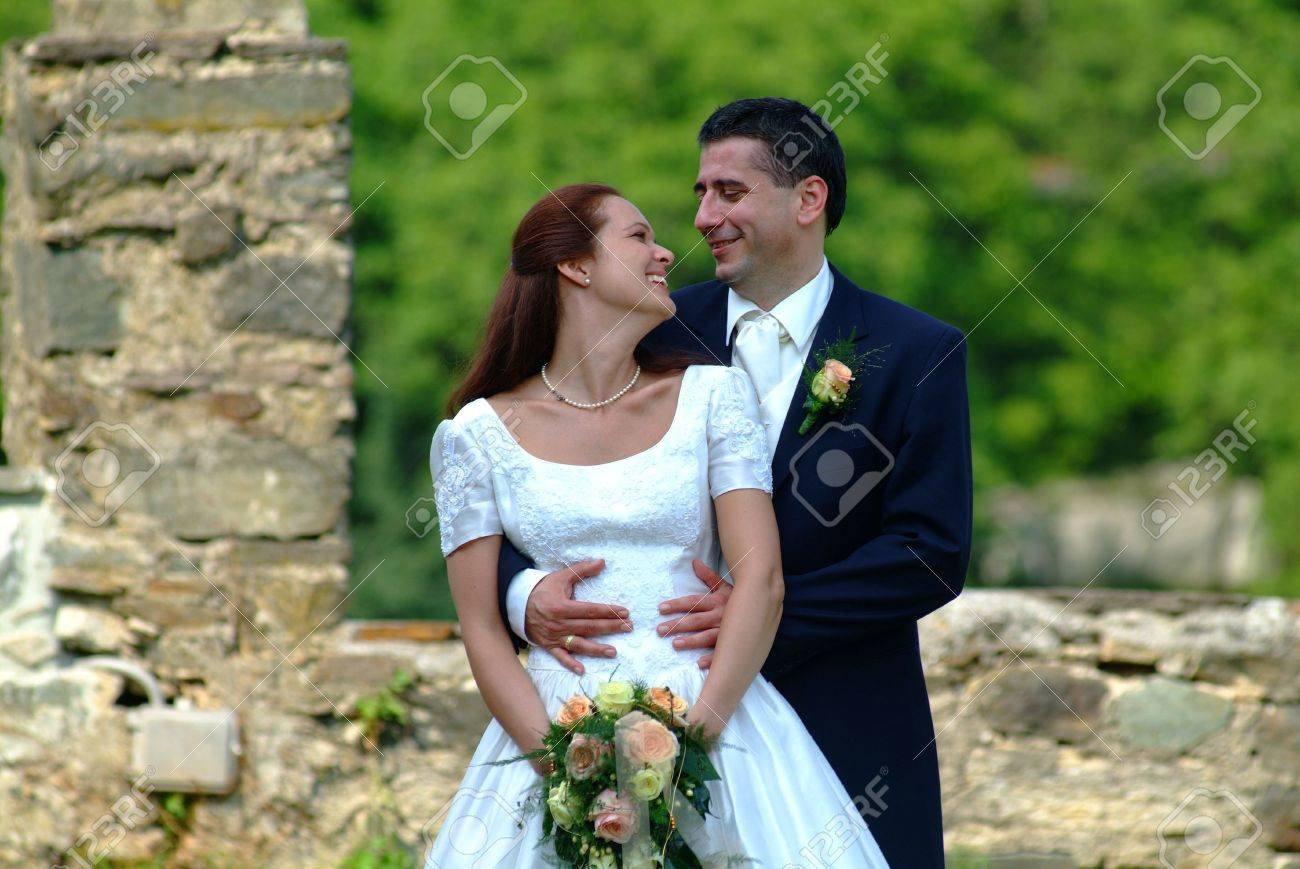 marriage  pair in front of a stones  wall Stock Photo - 650997