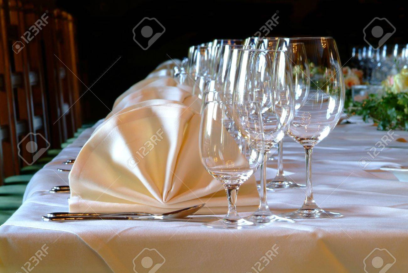 many glasses and yellow snapkins on decorated table Stock Photo - 649138