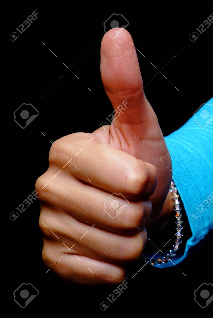 a young woman holds her thumb up Stock Photo - 727032