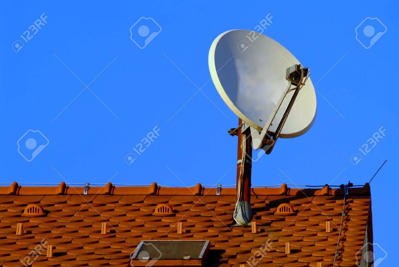 a white satellite dish on red roof Stock Photo - 740735