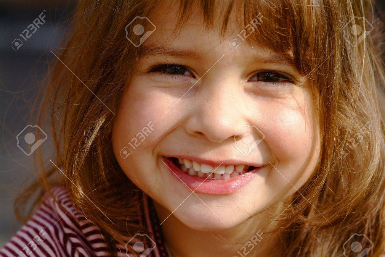 a nice laughing girl with brown hairs Stock Photo - 748693