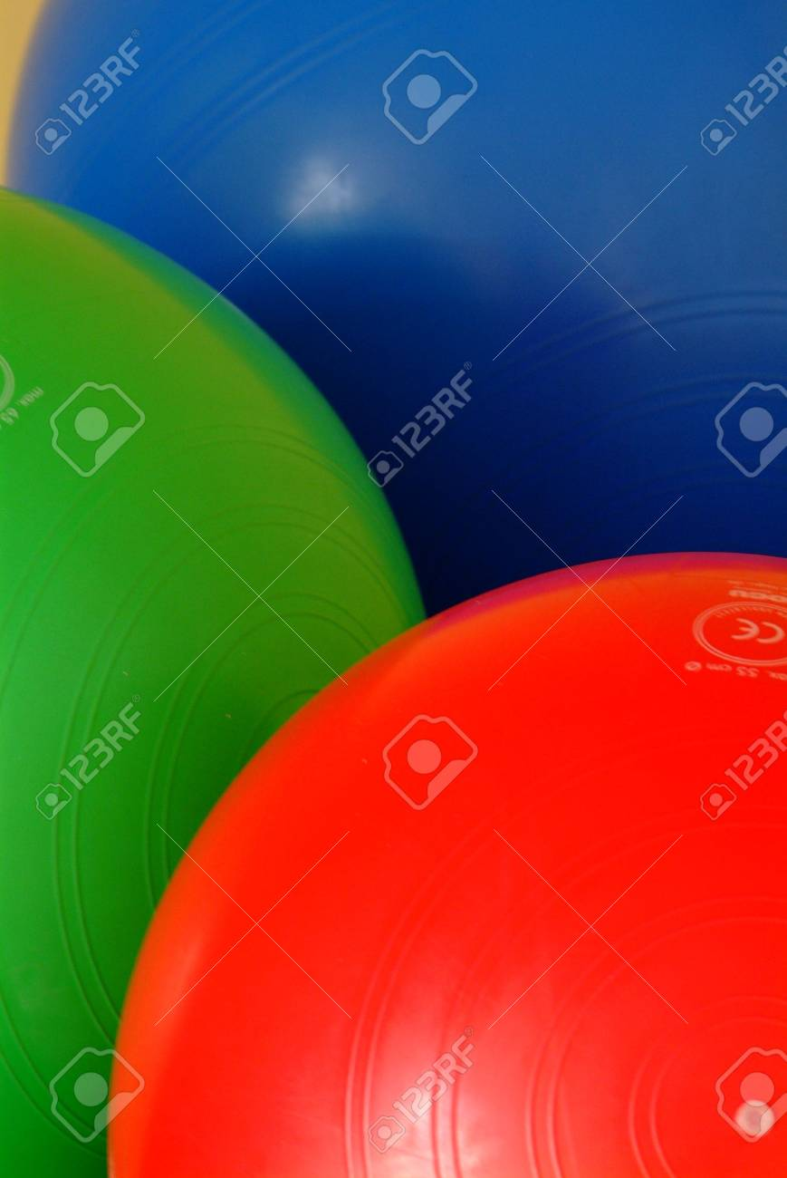 gym balls in blue red and green on the floor Stock Photo - 753633