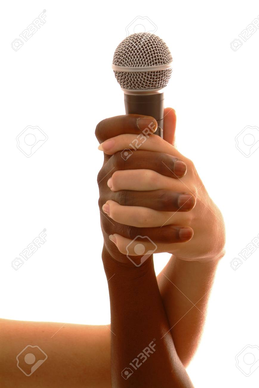 a black and a white hands holding micro Stock Photo - 757997