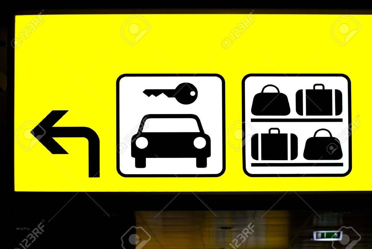 a yellow sign for parking garage and baggage room Stock Photo - 764642