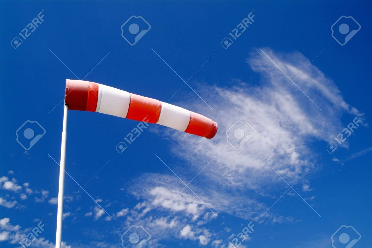 a wind sock and cloudy sky in the background Stock Photo - 779554