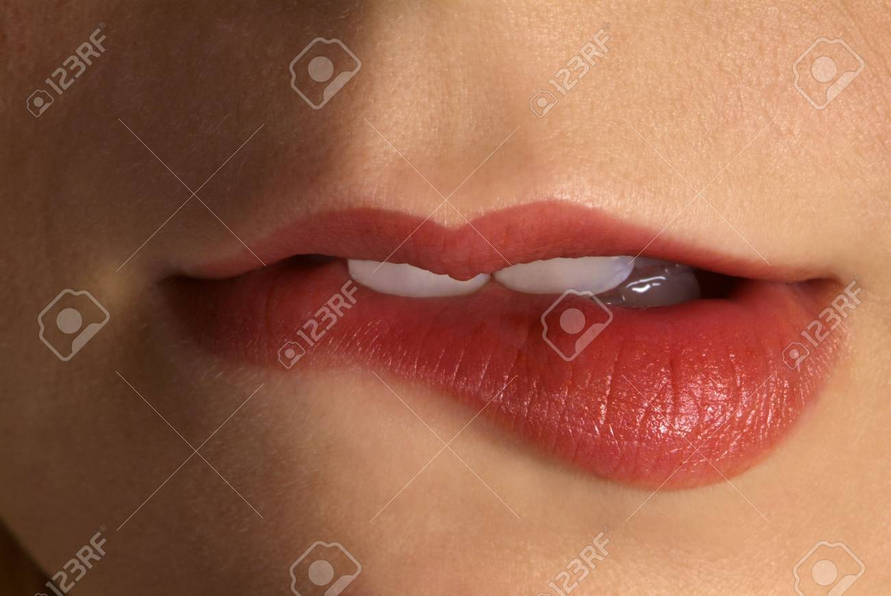 detail of a red made up lip and tooth Stock Photo - 2173757