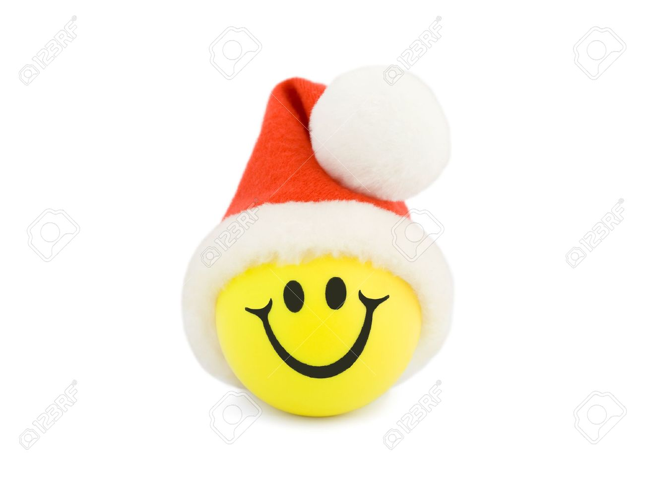 Tennis christmas ornaments - Christmas Smiling Tennis Ball In Christmas Hat Stock Photo 4597596