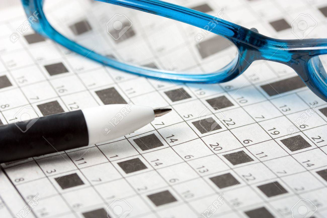 Pencil Spectacles On Crossword Puzzle Background Stock Photo
