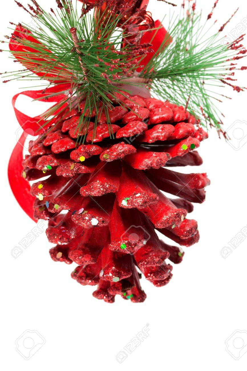 Red christmas pine cone and ribbons on white Stock Photo - 14479021