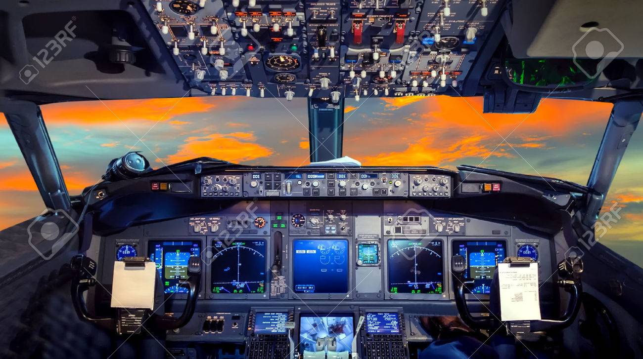 airplane cockpit flight deck in sunset stock photo picture and