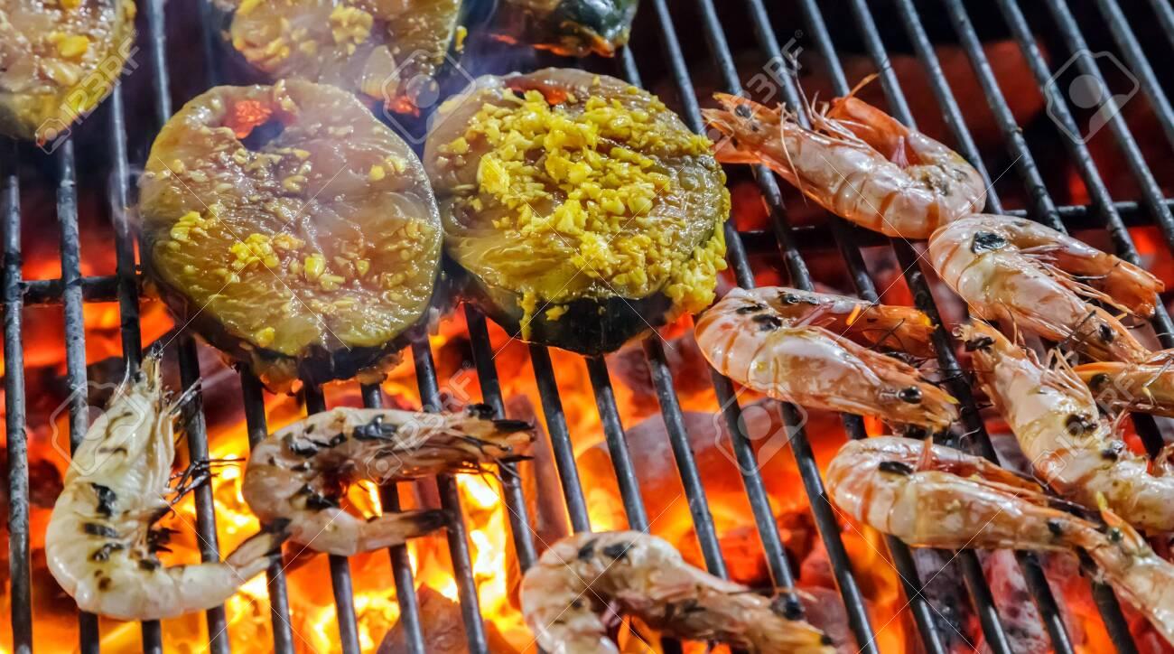 Closed up of shrimp roast, street food BBQ prawn and salmon slices. - 122838816