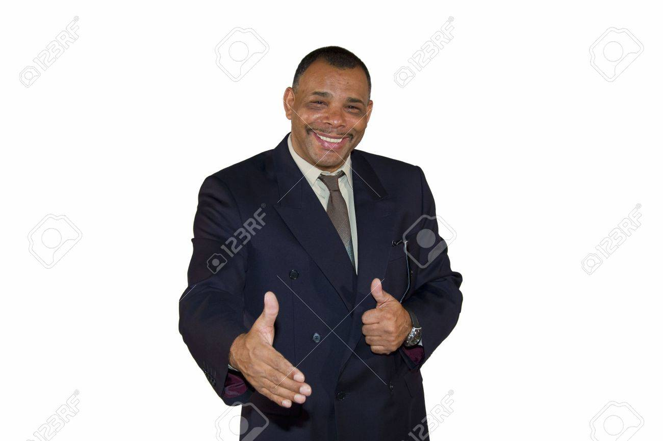 A smiling senior African-American businessman reaching out his hand for a welcoming handshake and posing with thumbs up, isolated on white background Stock Photo - 6473347