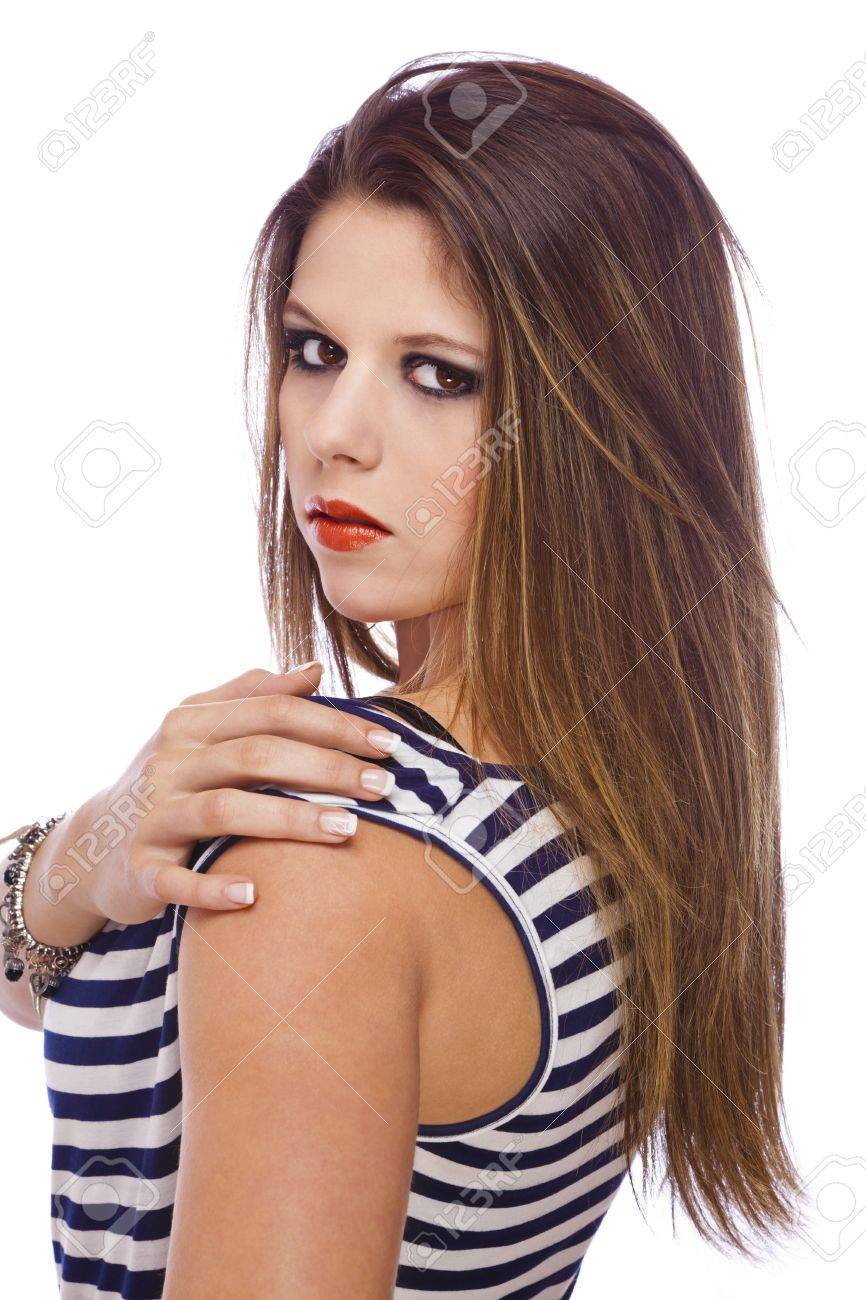 A cool looking beautiful teenage fashion model showing her acrylic fingernails, shot on white studio background Stock Photo - 12136396