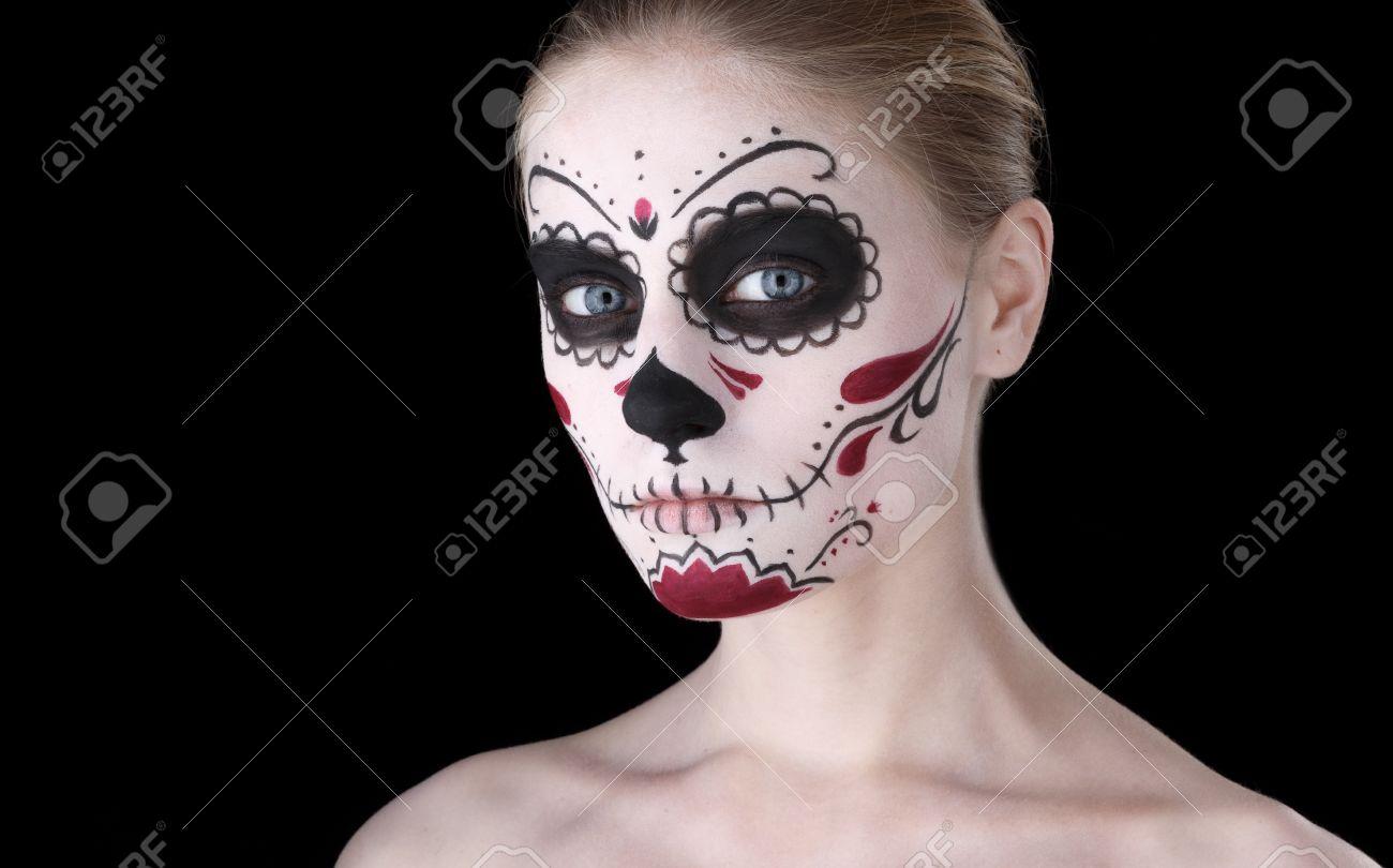 Stock Photo - Woman with dia de los muertos makeup, black empty space