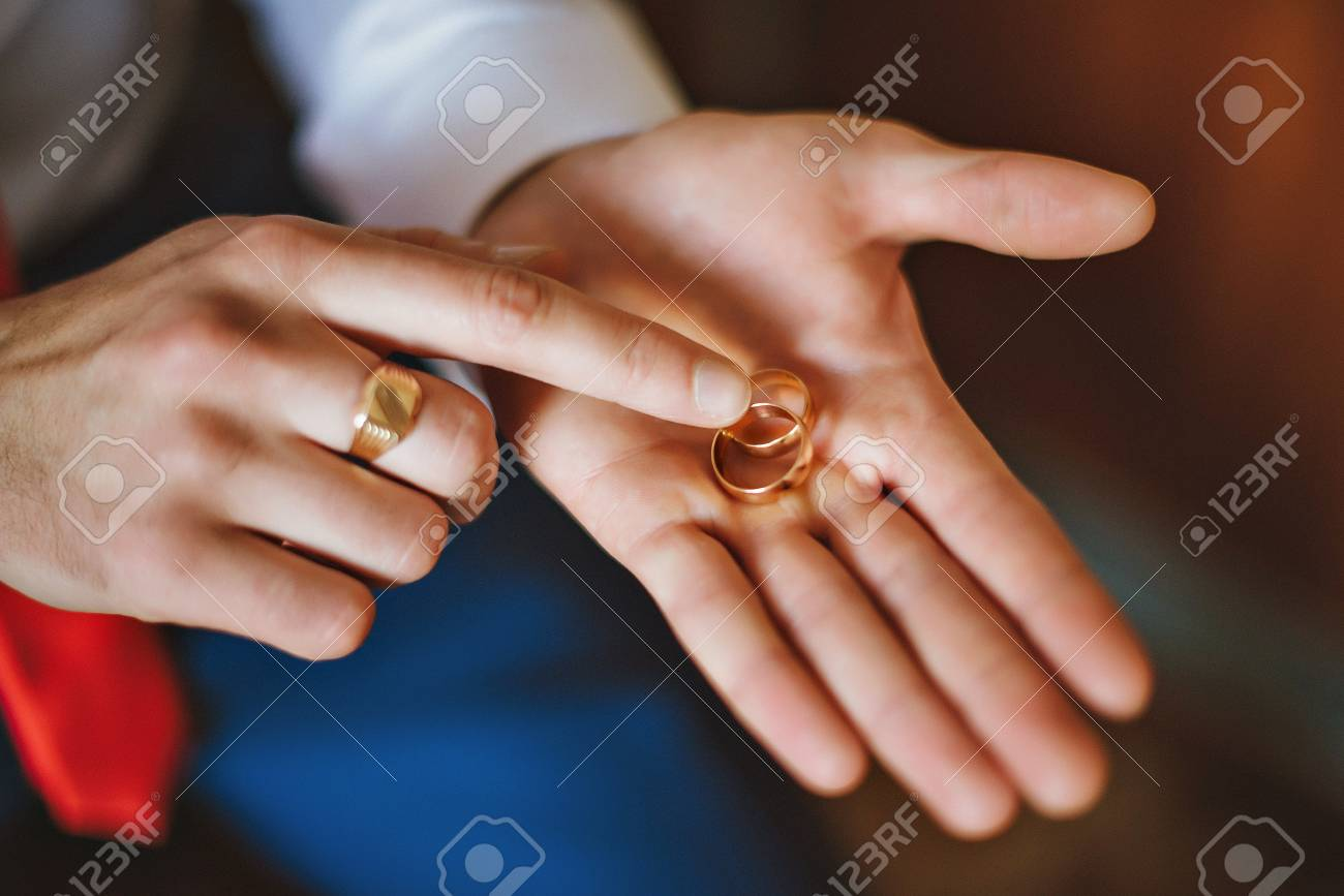Gold Wedding Rings At The Wedding In Man S Hands Stock Photo
