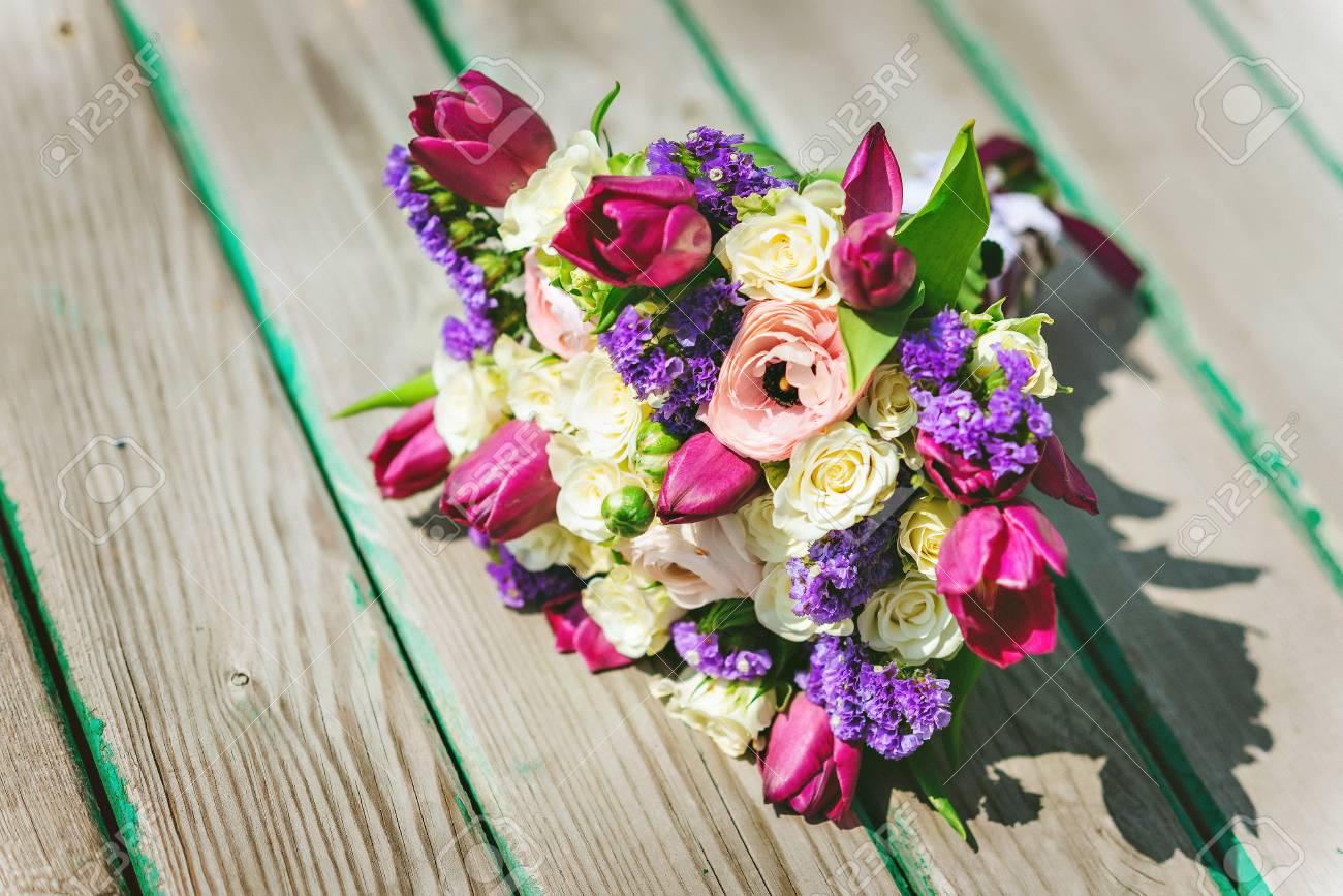 Wedding bouquet on a wooden pier purple white flowers stock photo stock photo wedding bouquet on a wooden pier purple white flowers mightylinksfo