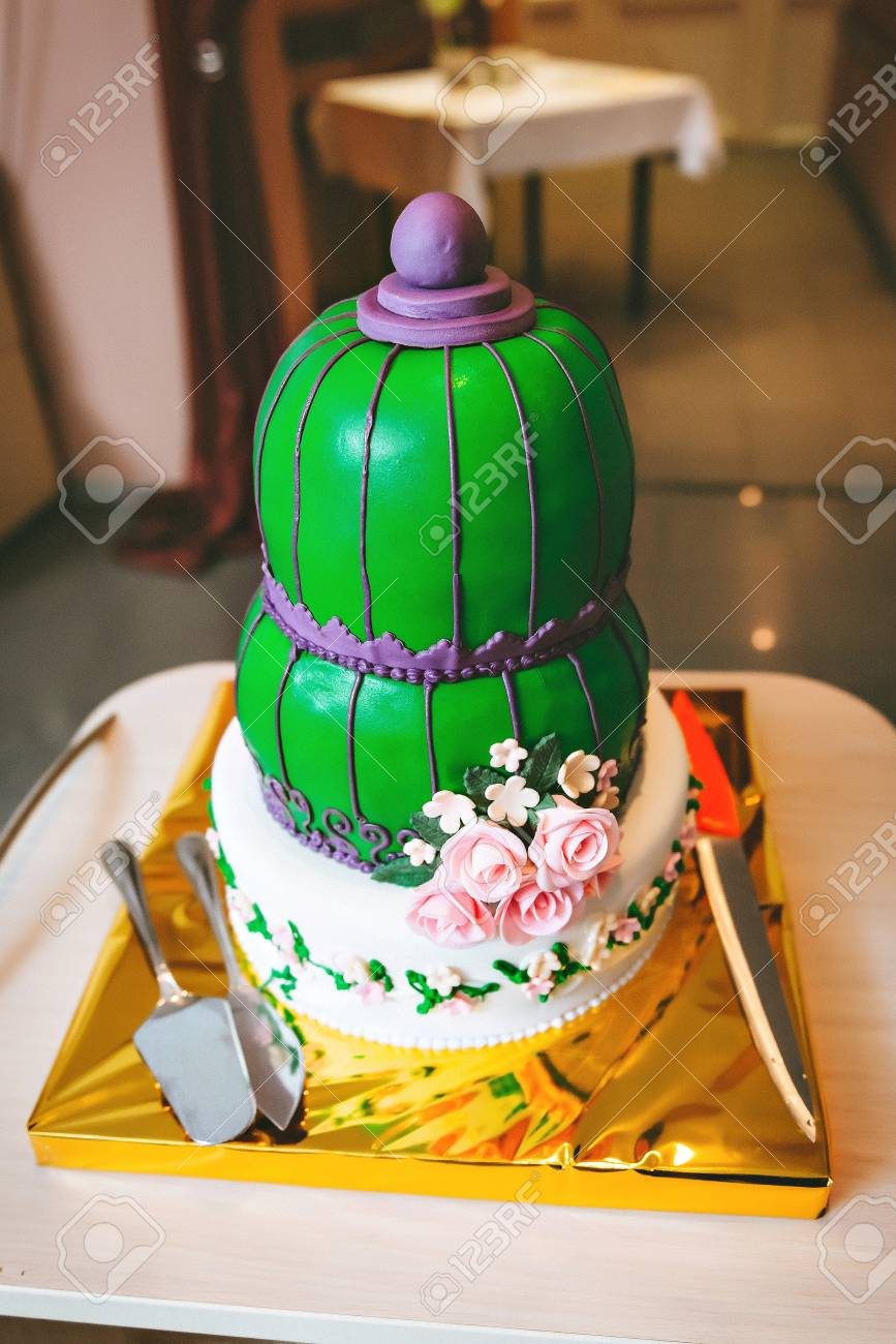 Green Purple Wedding Cake With Pink Flowers In An Oriental Style