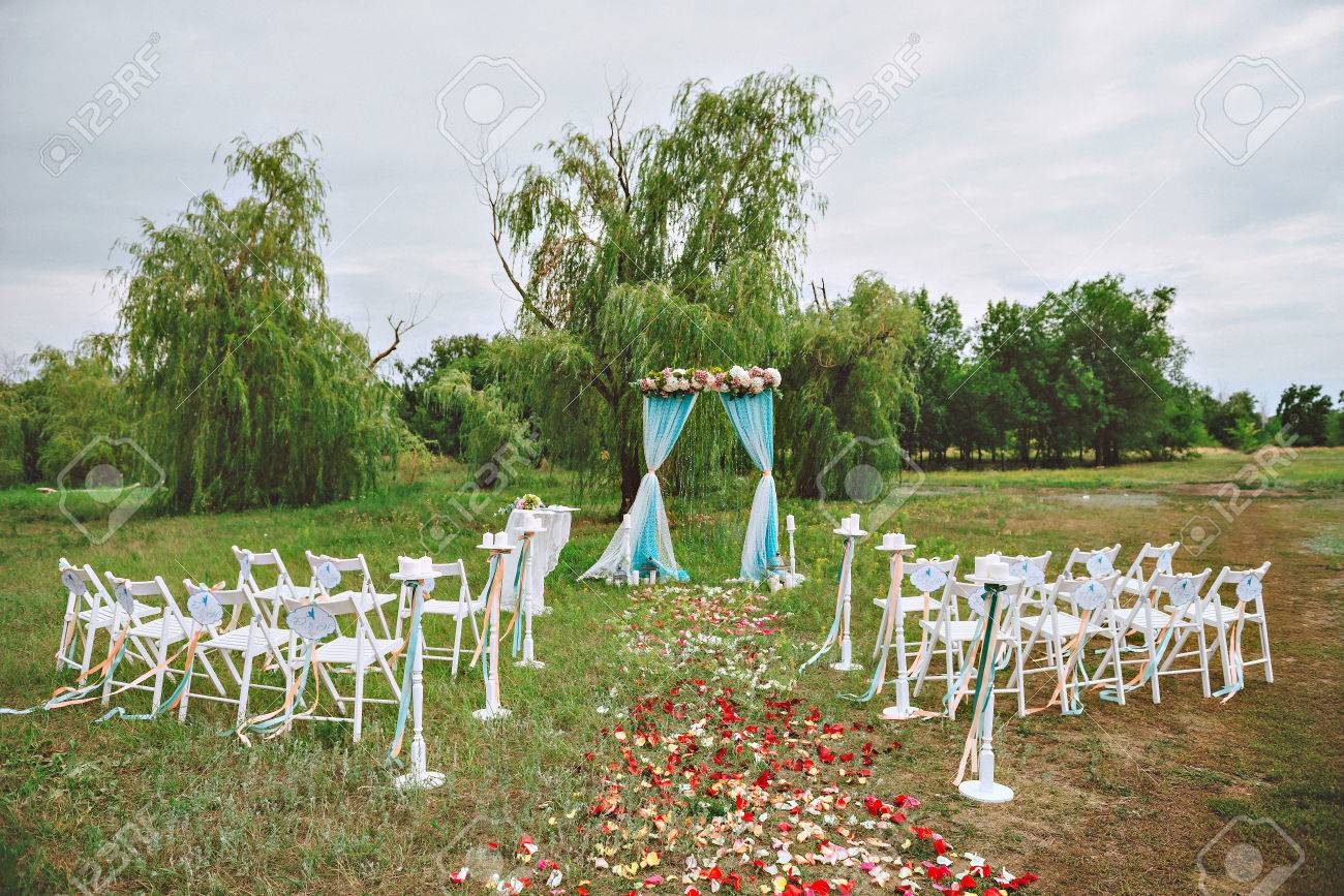 Wedding Decor On The Lawn Wedding Arch Chairs With Ribbons