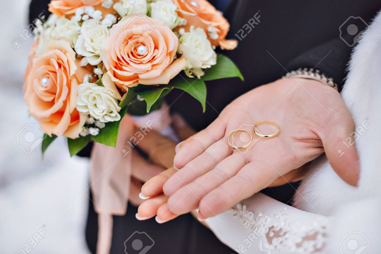 Newly Wed Couple\'s Hands With Wedding Rings. Stock Photo, Picture ...
