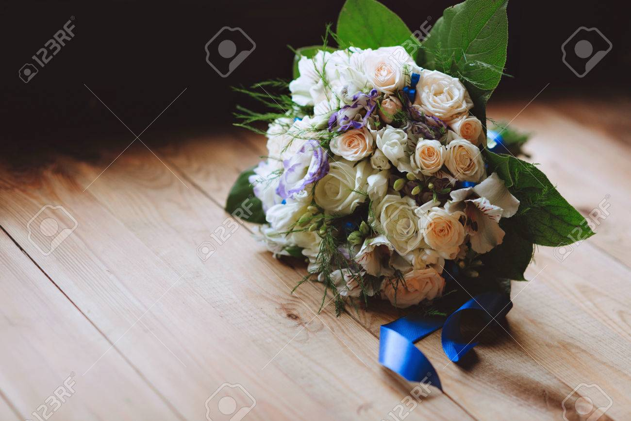 Wedding Bouquet On Wooden Background White Roses And Purple Stock