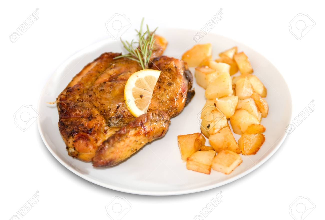 Roasted chicken with baby roast potatoes decorated with rosemary and lemon slices Stock Photo - 4993271