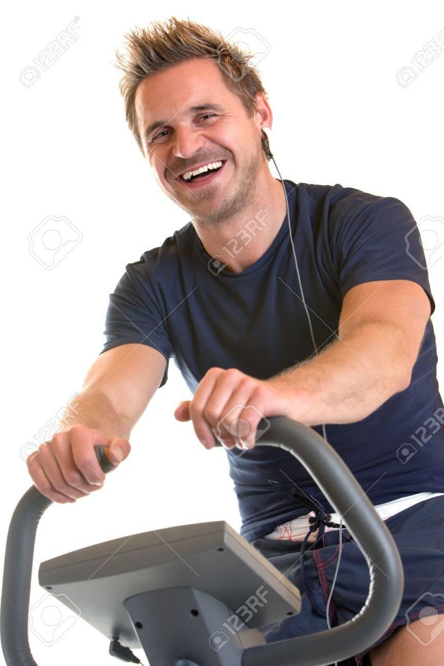 Man sitting on spinning bicycle Stock Photo - 5170289