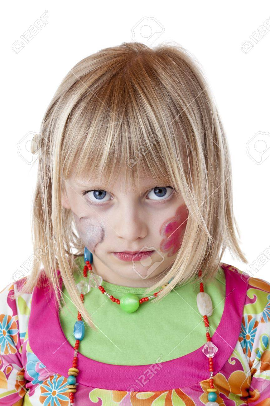 Blond disguised girl with painted cheeks looks serious.Isolated on white background. Stock Photo - 9752261