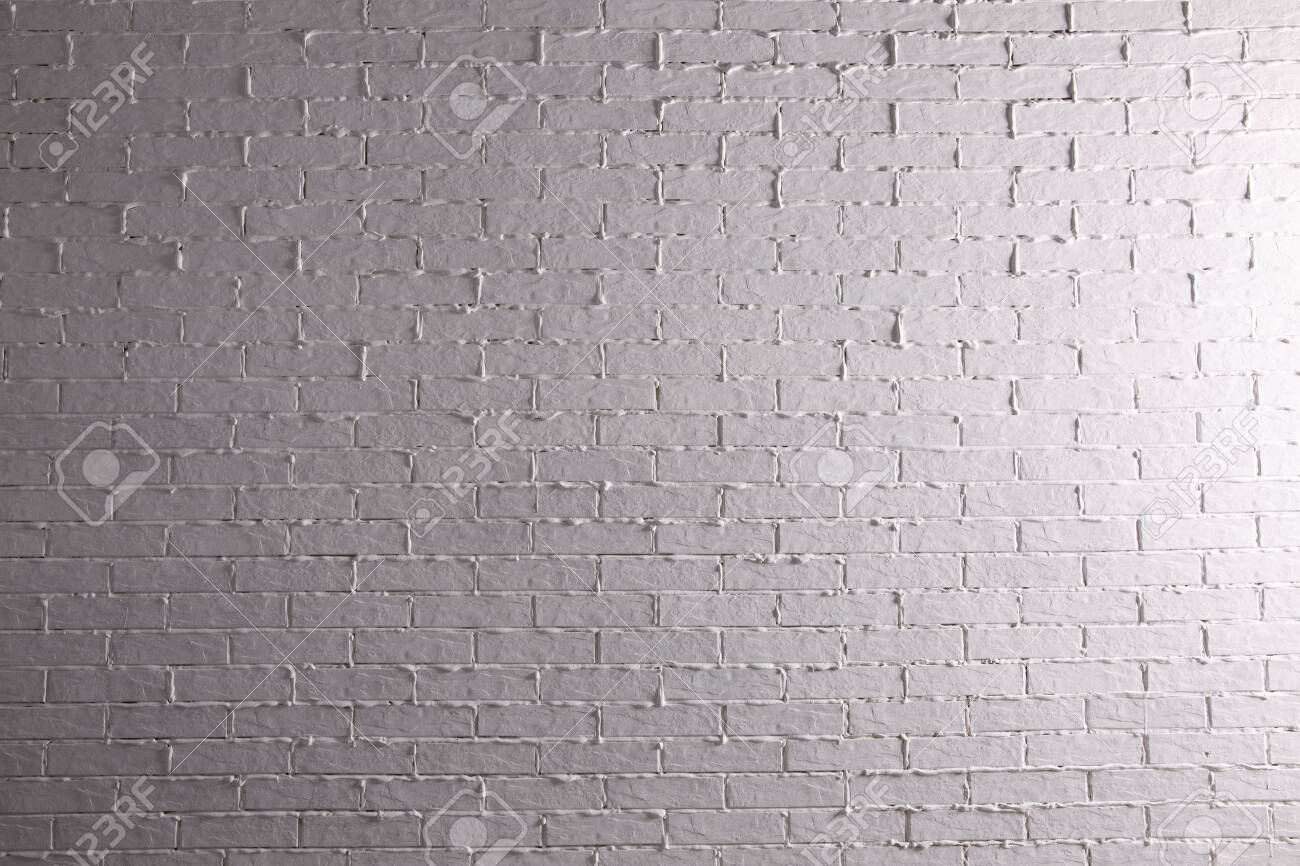 Brick painted white and properly illuminated reflects the interesting climate of its structure. - 144199280