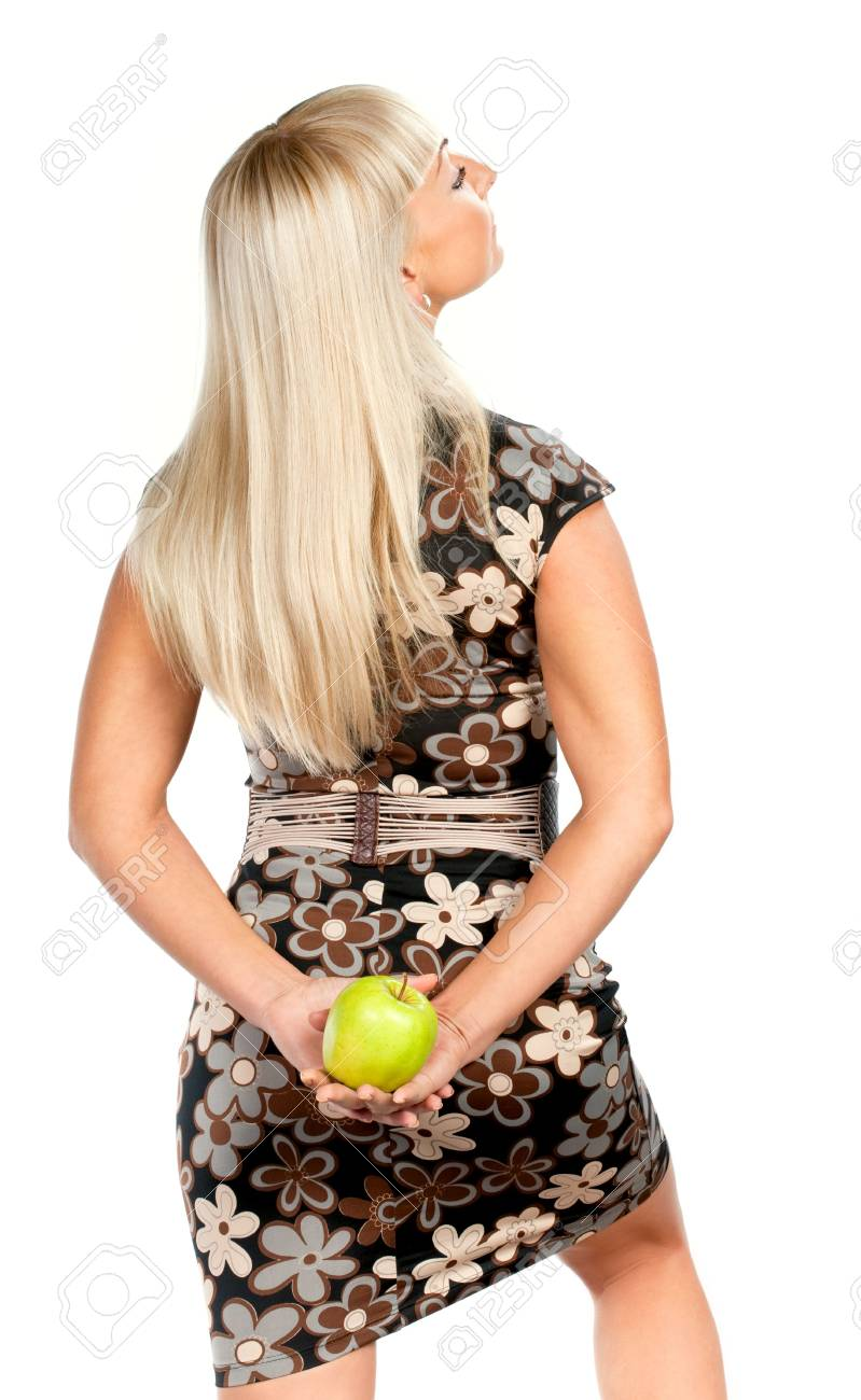 Blonde woman in flowered dress with green apple isolated Stock Photo - 6089788