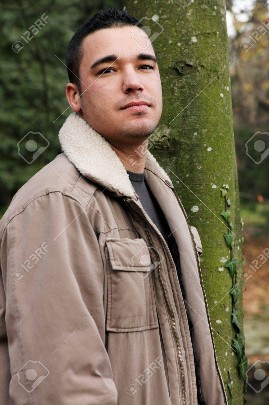 Autumnal portrait of a young man serious looking. Stock Photo - 10595627