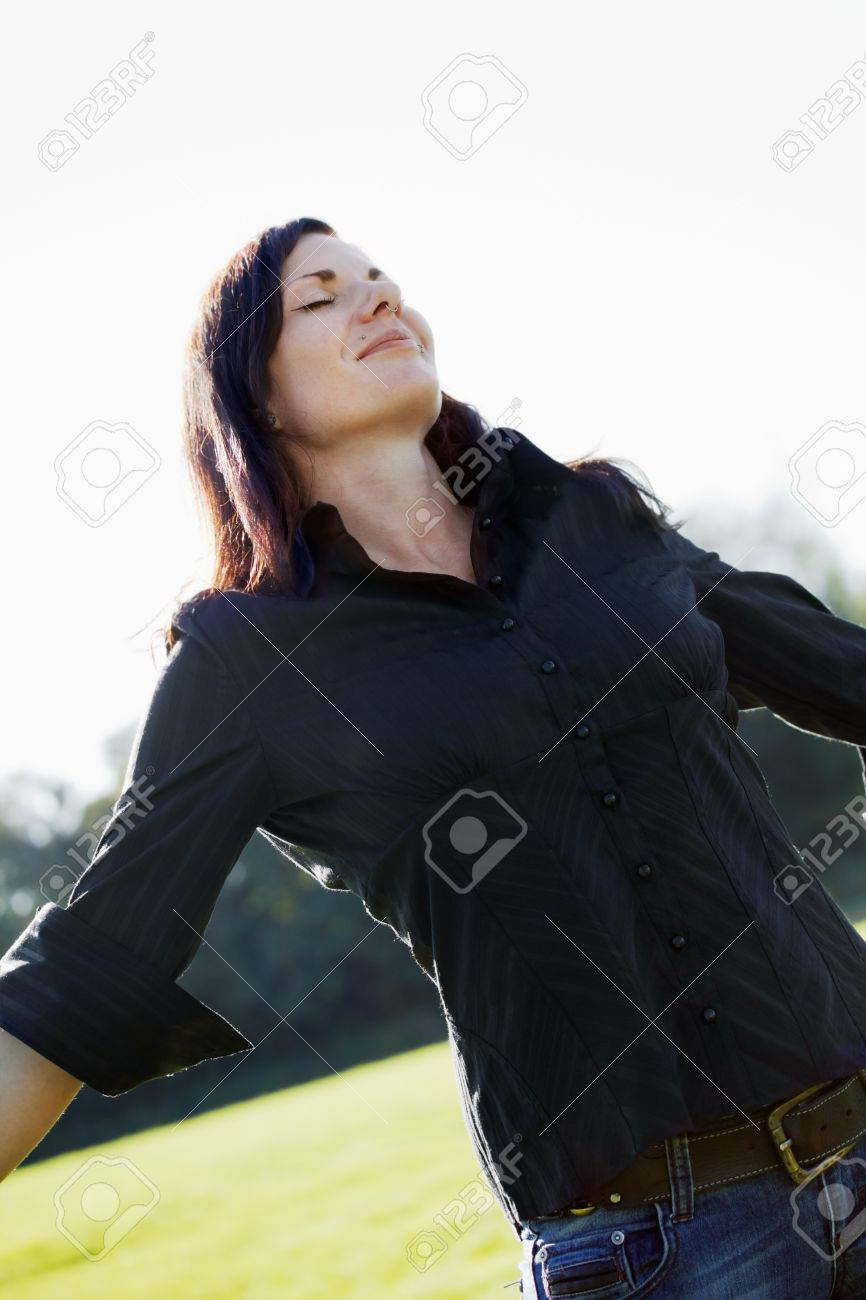 Happy young woman with spread arms. Stock Photo - 10837107