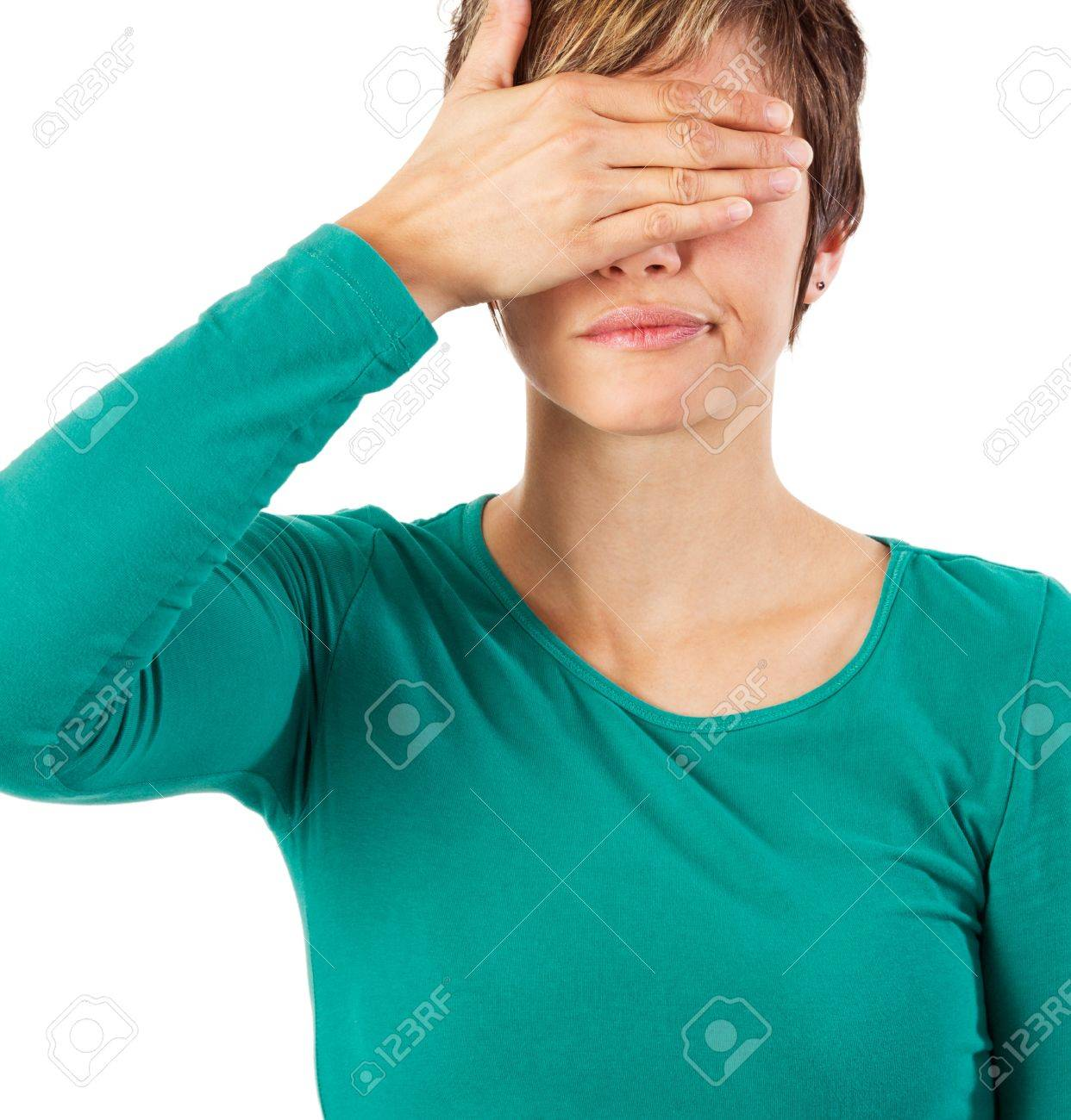 Young woman covering her eyes with her hand. Stock Photo - 12342870
