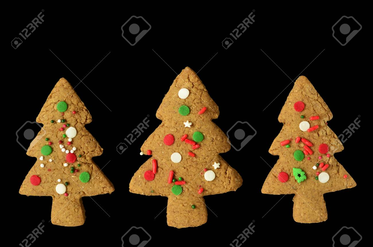 Gingerbread Christmas Tree Shaped Cookies Isolated On Black