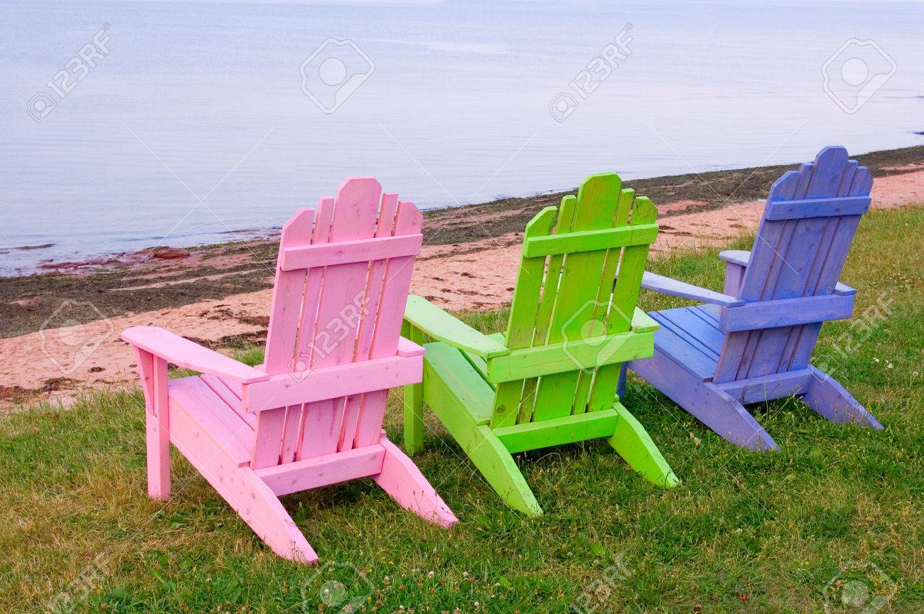 Three Wooden Lawn Chairs Pink Green And Blue On Grass By The Stock Photo Picture And Royalty Free Image Image 1767382