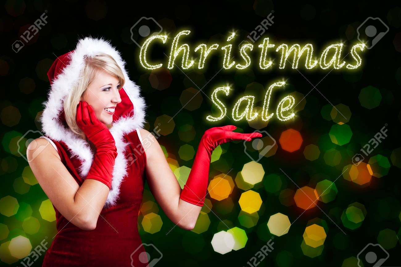 Attractive Miss Santa With Christmas Sale Sign Stock Photo, Picture ...