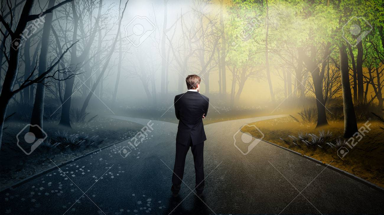 businessman has to decide which direction is better - 31041027