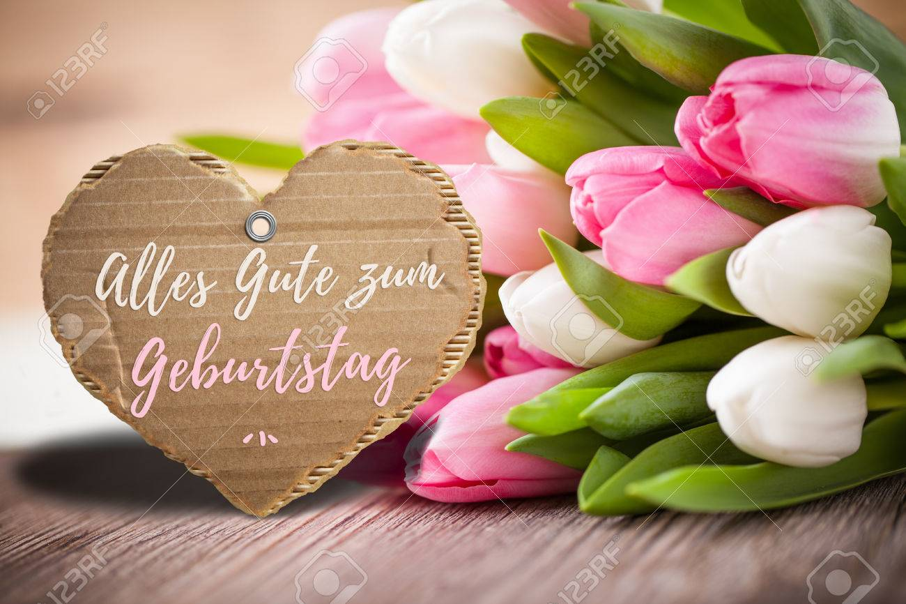 stock photo tulips with message saying happy birthday in german