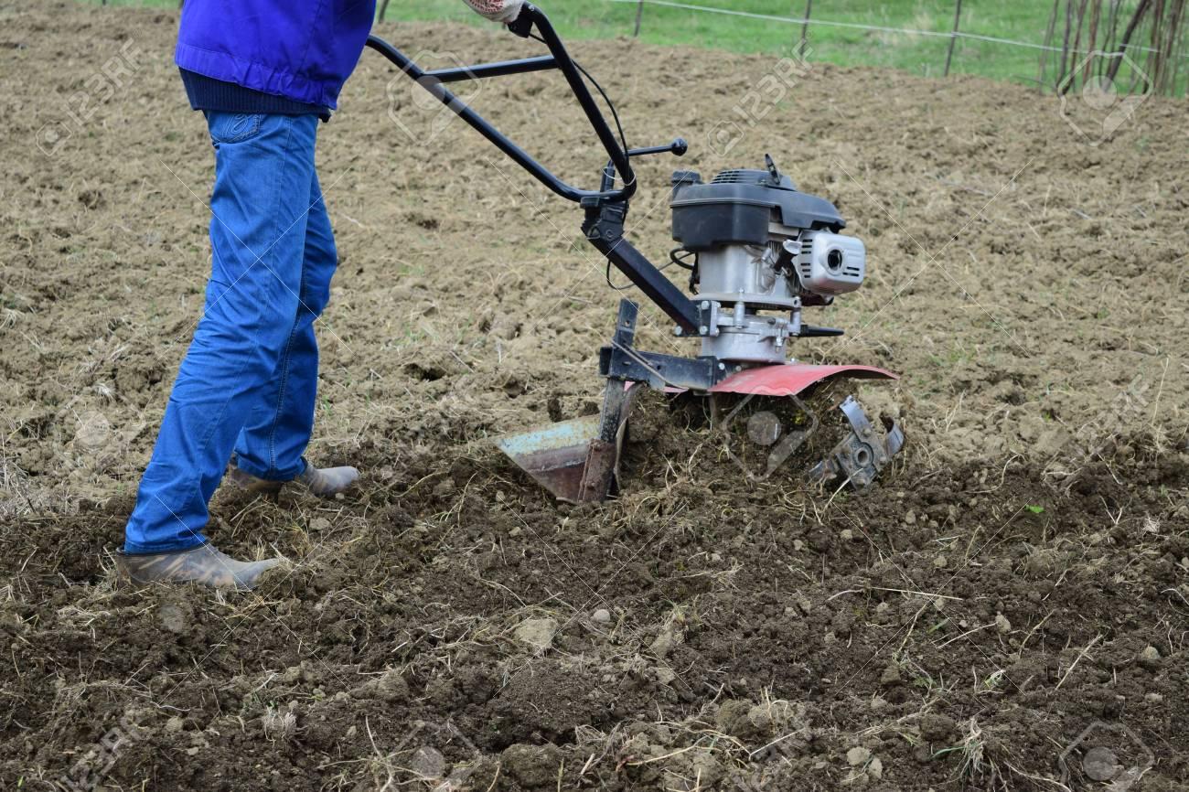 Walk Behind Tractor >> Planting Potatoes Under The Walk Behind Tractor Man With Motor Block