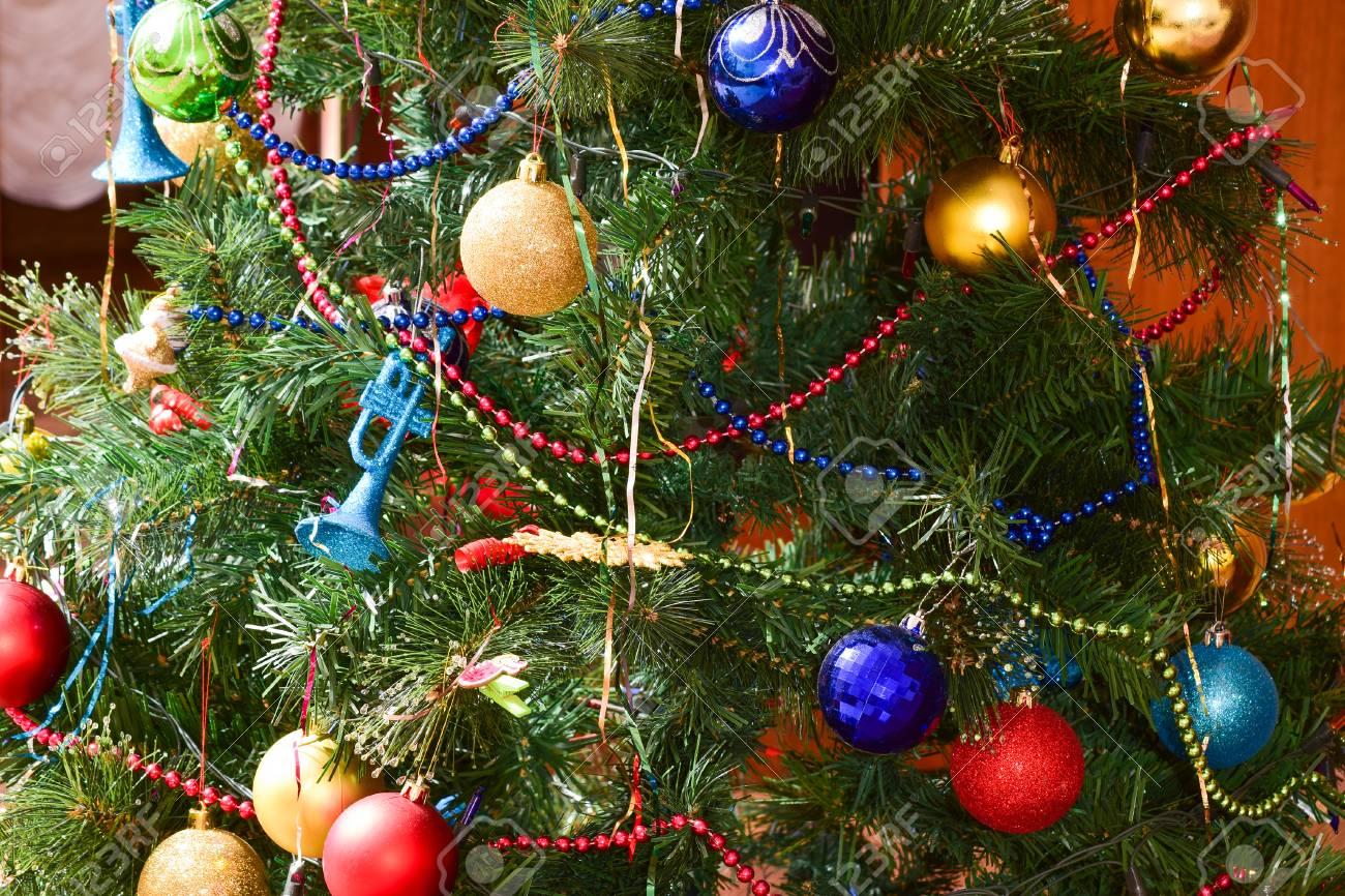 Christmas Tree Toys Decoration.Christmas Toys And Ornaments On The Christmas Tree Tinsel Balls